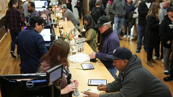 Image: Customers purchase marijuana at a dispensary in Oakland on the first