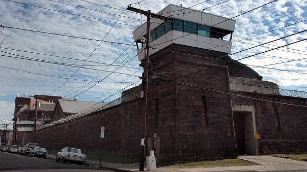Guard towers loom over the wall of New Jersey State Prison o