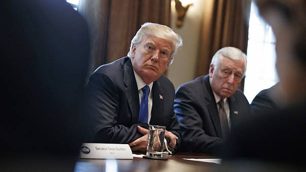 President Donald Trump listens during a meeting with lawmakers on immigration policy in the Cabinet Room of the White House, Tuesday, Jan. 9, 2018, in Washington.
