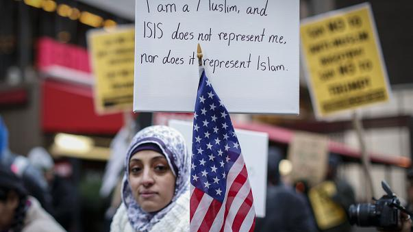 This file photo taken on December 20, 2015 shows a woman holding a poster during a protest in New York.