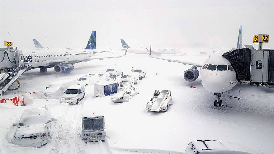 Image: Airplanes wait at the gates outside terminal five at John F. Kennedy