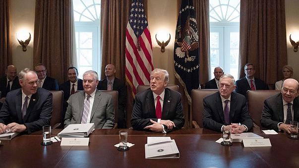 Image:  President Donald Trump, center, speaks during a cabinet meeting at