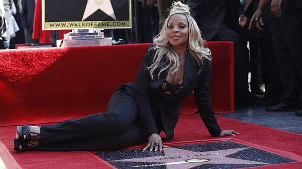 Mary J. Blige sits next to her star on the Hollywood Walk of Fame in Hollywood, California on Jan. 11, 2018.