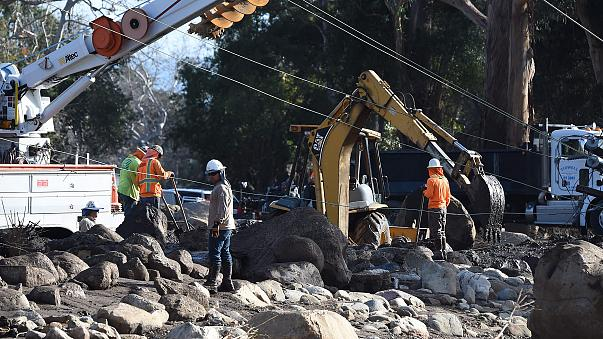 Crews work to remove downed power lines in Montecito, California, on Wednesday.