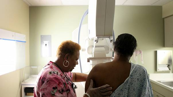 Betty Daniel, right, of Chicago, gets her routine yearly mammogram from Lead Mammography Tech Stella Palmer at Mt. Sinai Hospital in Chicago