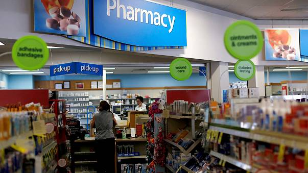 Image:  A customer waits at the counter of a CVS Pharmacy store in Pasadena