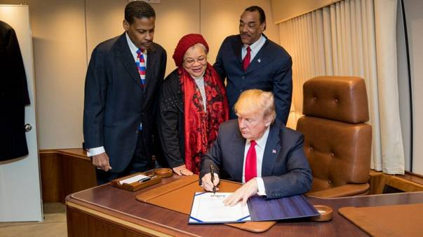 President Donald J. Trump, with Alveda King, center, niece of slain Civil Rights leader Dr. Martin Luther King Jr., and joined by Isaac Newton Farris Jr., left, nephew of Dr. King, and Bruce Levell of the National Diversity Coalition for Trump, right, sig