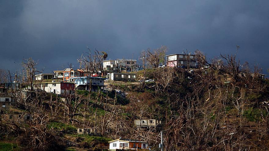 Image: Damaged houses are seen on top of a hill in Yabucoa, Puerto Rico