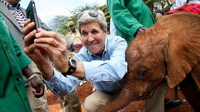 John Kerry's 'selfie' pose with baby elephant in Kenya