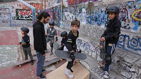 A group of young Syrian and Afghan refugees during a skateboarding lesson offered by the Free Movement Skateboarding in Athens.
