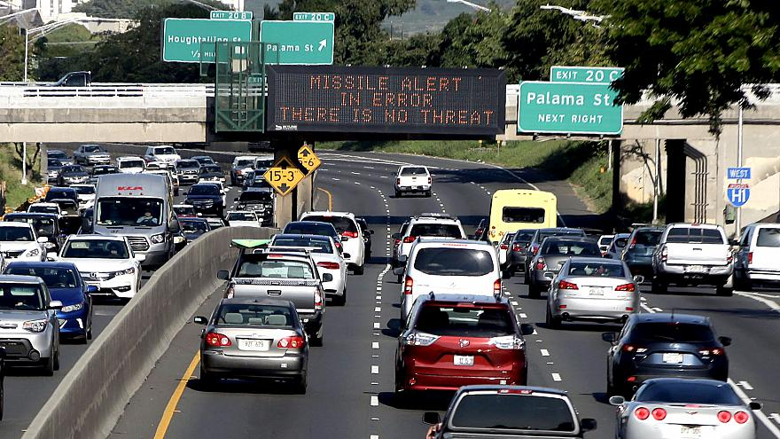 Image: Electronic signs displaying the emergency missile alert being fake i