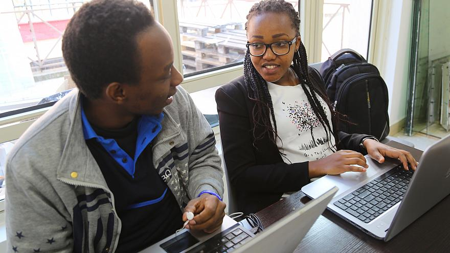 Image: Esther Muchei, 27, right, is a student at the Moringa School in Nair