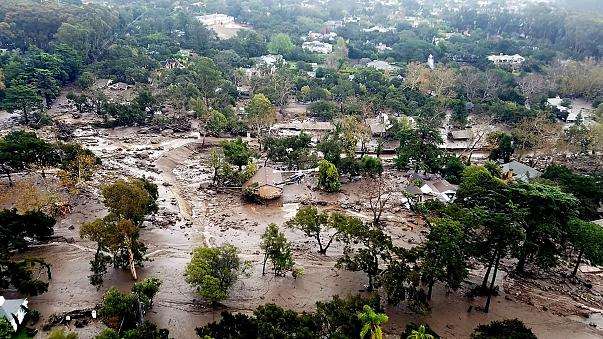 Image: Mudflow and damage from mudslides are pictured in this aerial photo