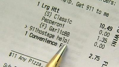 """""""I'm being held hostage"""" pleads woman in pizza order"""