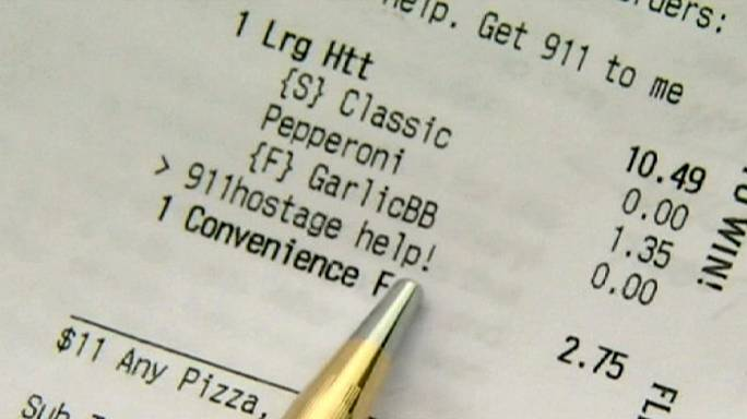 """I'm being held hostage"" pleads woman in pizza order"