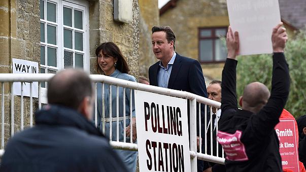 Candidates go to vote in closest British election in a generation