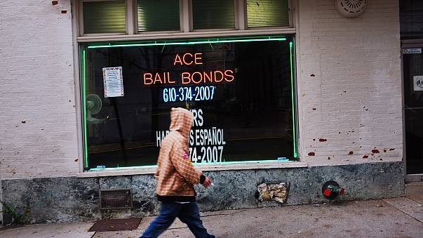 Image: A man walks by a bail bonds store on Oct. 20, 2011 in Reading, Penns