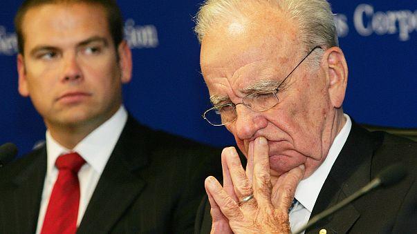 Image: Rupert Murdoch (R), chairman of media he