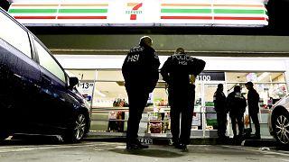 Image: U.S. Immigration and Customs Enforcement agents serve an employment