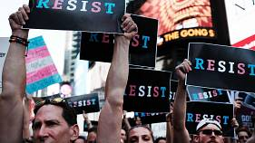 Protesters in Times Square near a military recruitment center show their anger at President Donald Trump's decision to reinstate a ban on transgender individuals' serving in the military on July 26, 2017.