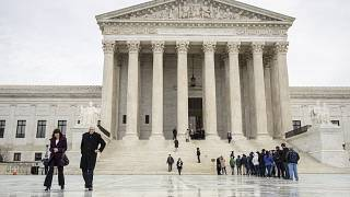 Image: People stands on the plaza of the U.S. Supreme Court in Washington t