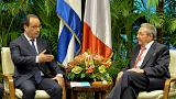 Hollande meets Castro brothers during French state visit to Cuba