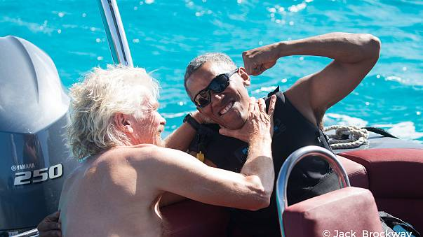 Image: Obama kids around with Richard Branson in Moskito on the British Vir