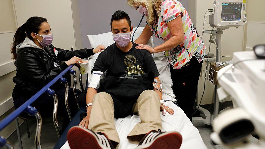 Image: Emergency room nurse Christine Bauer treats Joshua Lagade of Vista,