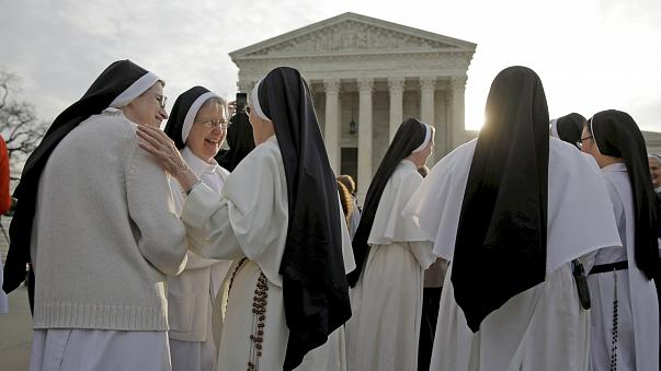 Image: Nuns speak to each other before Zubik v. Burwell is heard by the U.S