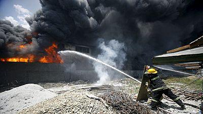 Fire kills dozens in Manila slipper factory fire