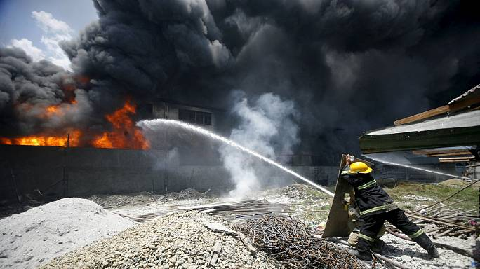Fire kills dozens in Manila slipper factory fire