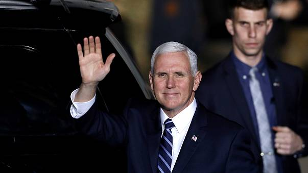 Image: Vice President Mike Pence waves after arriving at Ben Gurion Interna