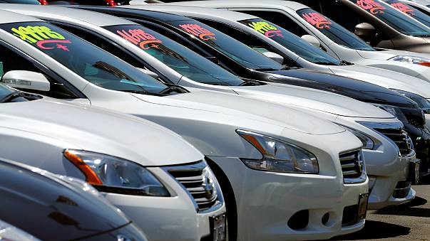Image: Automobiles are shown for sale at a car dealership in Carlsbad, Cali
