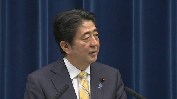 Japan cabinet approves draft laws to expand military role