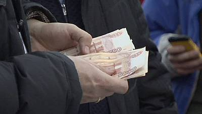 Rouble slides as Russia buys foreign exchange