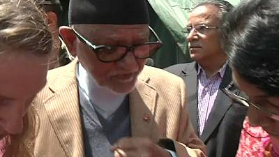 Nepalese PM visits quake zone and takes woman to hospital in his helicopter