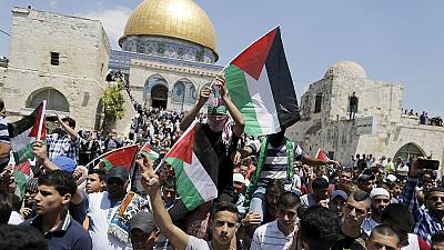 Palestinians demonstrate and march to mark Nakba Day