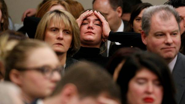 Image: A victim reacts as Larry Nassar speaks during his sentencing hearing