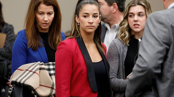 Image: Victim and former gymnast Aly Raisman appears before speaking at the