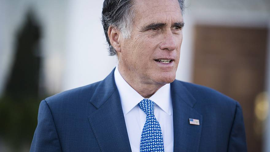 Image: Mitt Romney talks to the media after meeting with President-elect Do