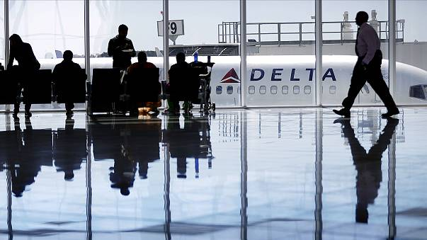 Image: A Delta Air Lines jet sits at a gate at Hartsfield-Jackson Atlanta I