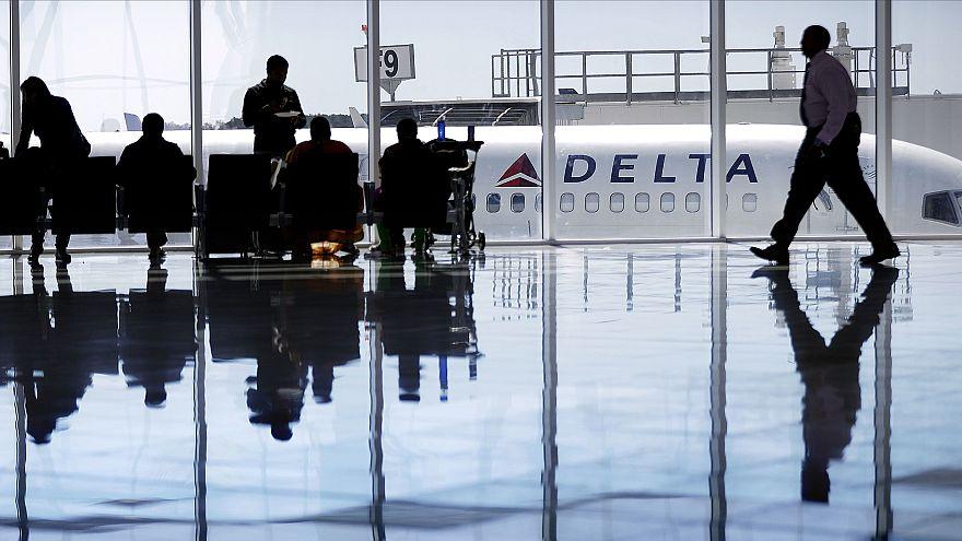Image: A Delta Air Lines jet sits at a gate at Hartsfield-Jackson Atlanta I