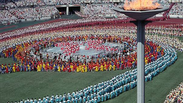 Image: Athletes from a 160 nations parade during the Olympics opening cerem