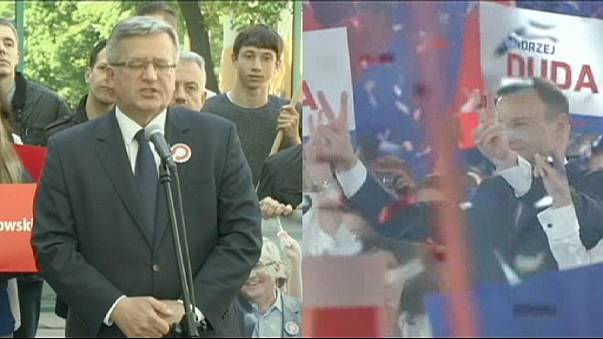 Komorowski threatened by right-wing rival Duda in Poland's presidential run-off