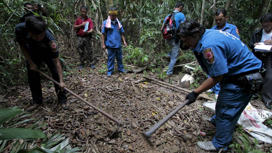 Dozens of suspected migrant graves found near Malaysia-Thailand border, police reveal