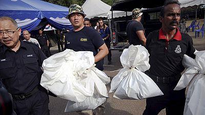 Mais de uma centena de migrantes sepultados na selva da Malásia