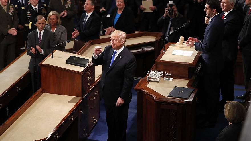 Image: Trump is greeted as he arrives to deliver his State of the Union add