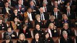 Image: Democratic members of congress listen as U.S. President Trump delive