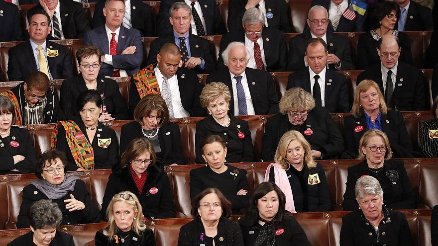 Image: Democratic members of congress listen as U.S. President Trump delive