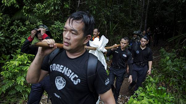 Malaysia: Police officials arrested as over 100 'migrant graves' discovered
